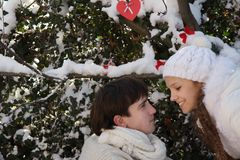Young couple on natural winter background Royalty Free Stock Images