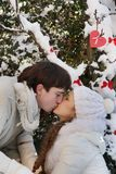 Young couple on natural winter background Stock Photos