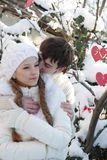 Young couple on natural winter background. Young loving couple on natural winter background Royalty Free Stock Photos