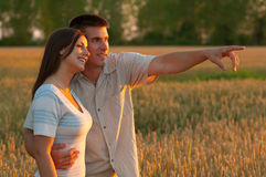 Young couple in the nature on sunny summer day Royalty Free Stock Photography