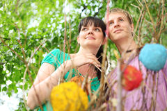 Young couple near branch Royalty Free Stock Photos