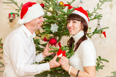Young couple near Christmas tree at home Stock Photography