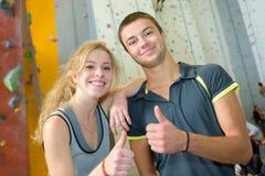 Young couple near climbing wall royalty free stock photos