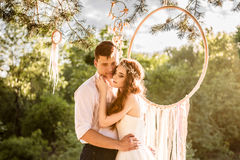 Young couple near dreamcatcher at forest Royalty Free Stock Images