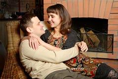 Young couple near fireplace Stock Photos