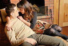Young couple near fireplace Stock Photography