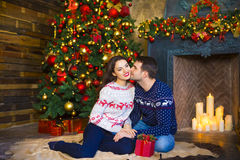 Young couple near fireplace celebrating Christmas Royalty Free Stock Photo