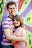 Young couple near graffiti background. Royalty Free Stock Photos