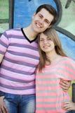Young couple near graffiti background. Stock Image