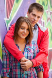 Young couple near graffiti background. Royalty Free Stock Photography
