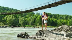 Young Couple near Katun and suspension bridge stock video