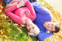 Young couple near lake, autumn time Royalty Free Stock Photography