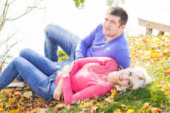 Young couple near lake, autumn time Stock Photos