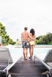 Young couple near swimming pool Royalty Free Stock Photos