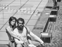 Young couple near swimming pool. Young couple of pretty women and bearded men enjoy sunny summer vacation near swimming pool Royalty Free Stock Photo