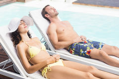 Young couple near swimming pool Stock Images