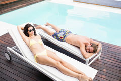 Young couple near swimming pool Royalty Free Stock Image