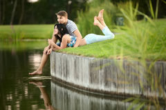 Young couple near water Royalty Free Stock Photo
