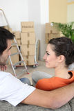 Young couple in new apartment Stock Photos