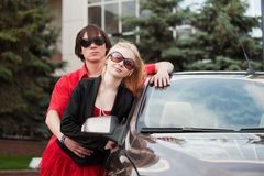 Young couple with a new car. Stock Photo