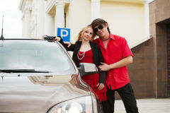 Young couple with a new car. Royalty Free Stock Image