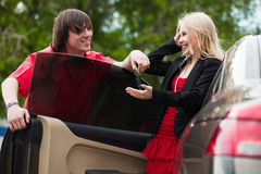 Young couple with a new car Royalty Free Stock Images