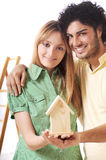 Young couple and new home. Young couple purchase new home, smile and look in camera Stock Photo