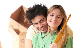Young couple and new home. Young couple purchase new home, smile and look in camera Stock Images