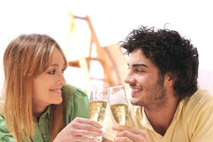 Young couple and new home. Young couple purchase new home, to toast with fizzy Royalty Free Stock Photography