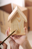 Young couple and new home. Young couple purchase new home, hands and little house Stock Photos