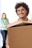 Young couple and new home. Young couple purchase new home, smile and look in camera Royalty Free Stock Photos