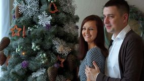 Young couple at the new year tree. Young couple, romantic evening at the new year tree stock video footage