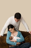 Young couple and newborn baby. Royalty Free Stock Images