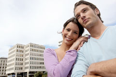 Young couple next to buildings Stock Photography