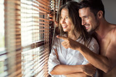 Young couple next window Royalty Free Stock Photo
