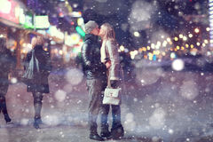Young couple at night street. Young couple kissing at night street royalty free stock photography