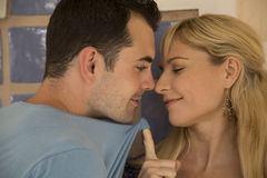 Young couple nose to nose in playful aggression Royalty Free Stock Photos