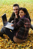 Young couple with notebook Stock Images