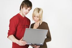 Young couple and notebook Royalty Free Stock Photos
