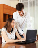 Young couple  with notebook at home Royalty Free Stock Photography