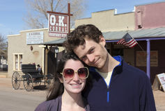 A Young Couple at the O.K. Corral, Tombstone. Tombstone, Arizona - February 2: Allen Street on February 2, 2013, in Tombstone, Arizona. A wagon at the O.K stock photos