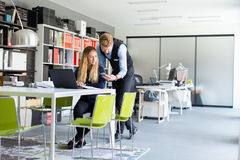Young couple in office Royalty Free Stock Photography