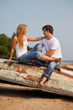 Young couple on old boat Royalty Free Stock Image