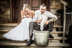 Young couple on the old-fashioned porch Stock Photos
