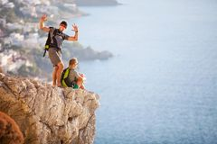 Young Couple On Rock And Enjoying Beautiful View Royalty Free Stock Photography