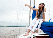 Young couple onboard the yacht royalty free stock image