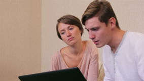 Young couple. Online shopping stock video footage