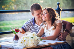 Young couple in an open-air cafe Royalty Free Stock Photos