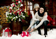 Young couple opening presents Royalty Free Stock Images
