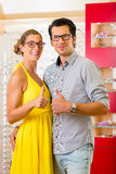 Young couple at optician with glasses Stock Photo